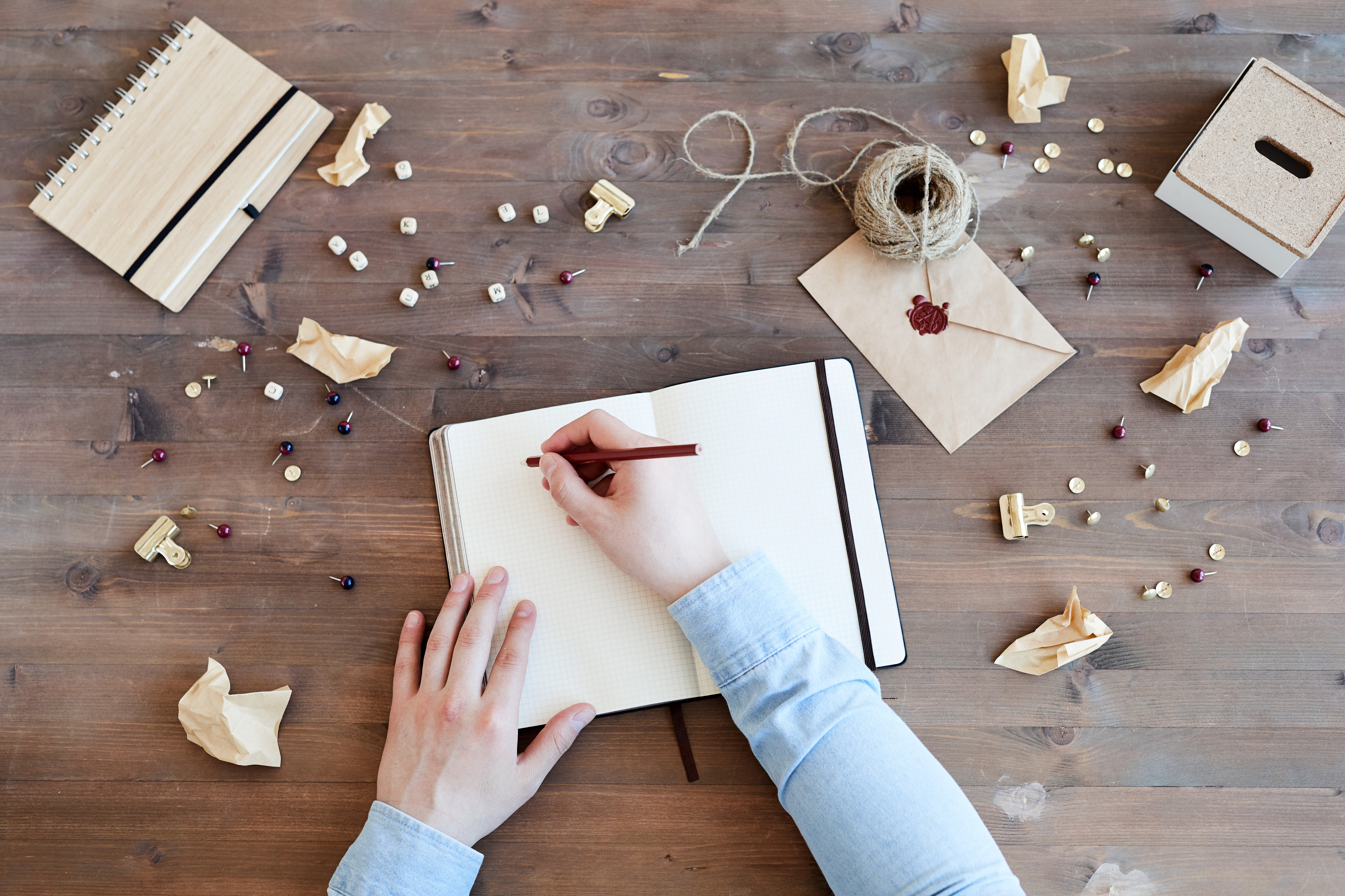 mess-on-desk-of-creative-director-PRWTZSX